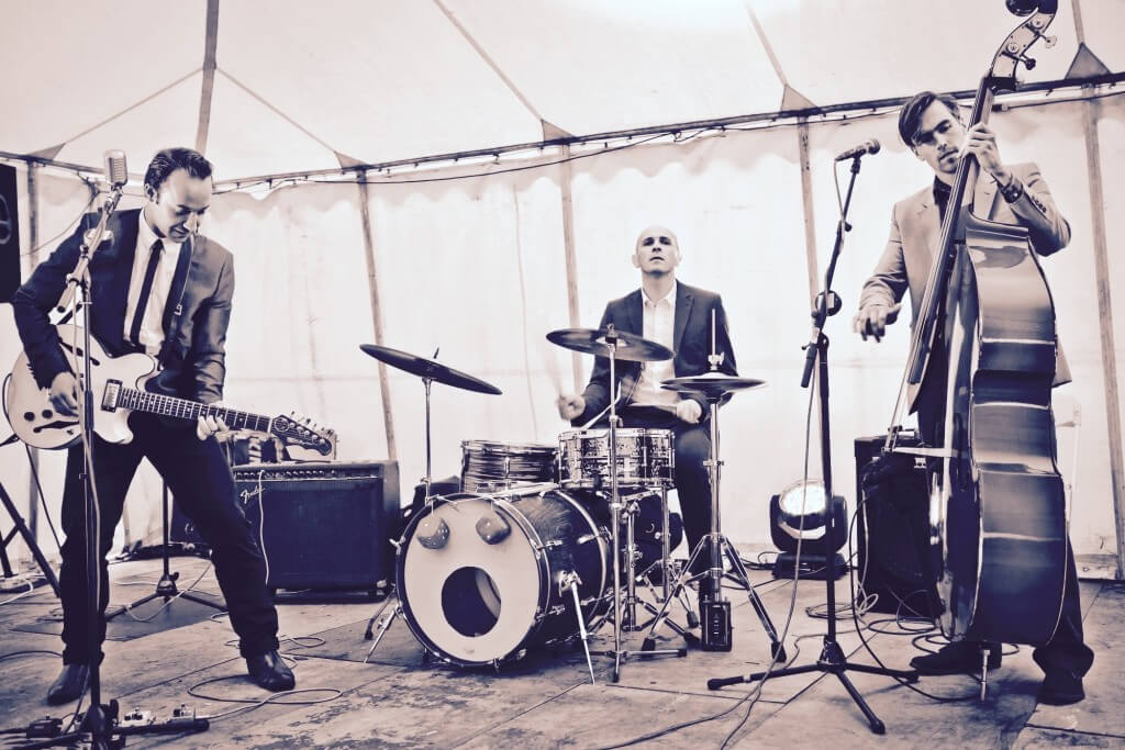 Hailbails performing live in a marquee